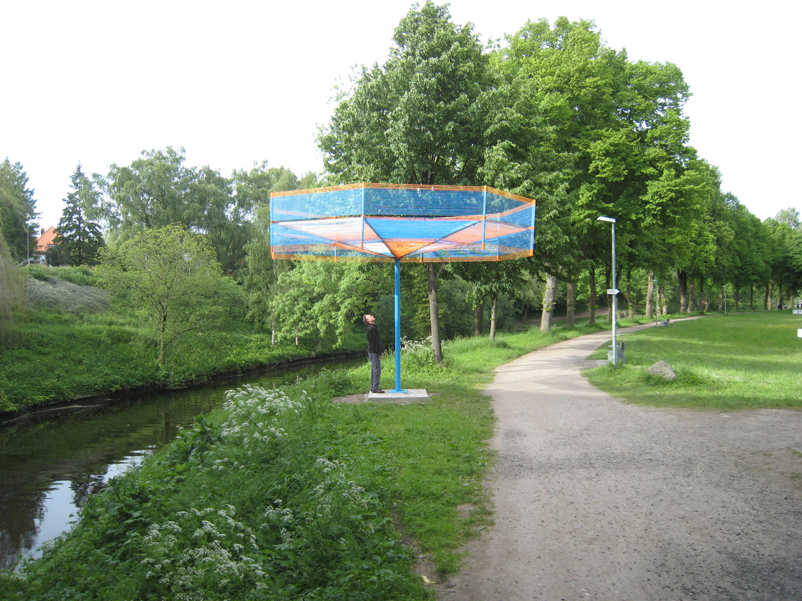 Carousel 2013 welded steel, 40,000 feet of baler twine, solar LED lights, 10x18x18ft (Skulpturenpark, Stade, Germany) day