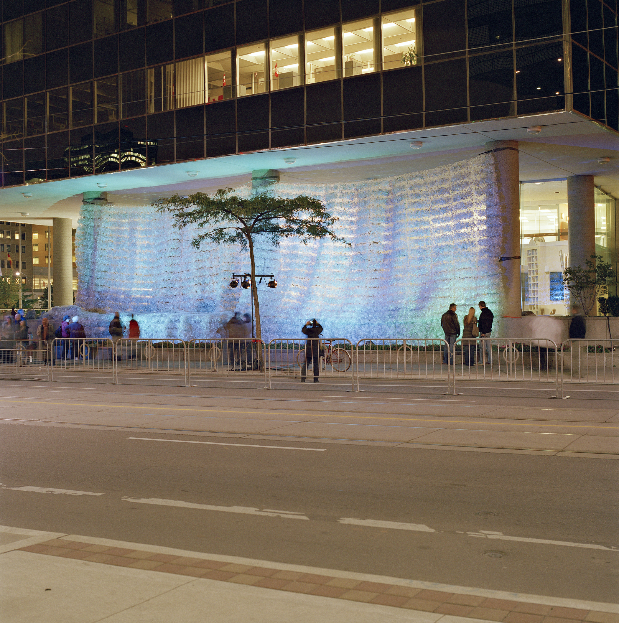 Waterfall street view 2008 6000 lbs of recycled water bottles, hockey netting, aircraft cable, 30x74x20ft (College St and University Ave, Toronto) Commissioned by Scotiabank Nuit Blanche photo by Peter MacCallum