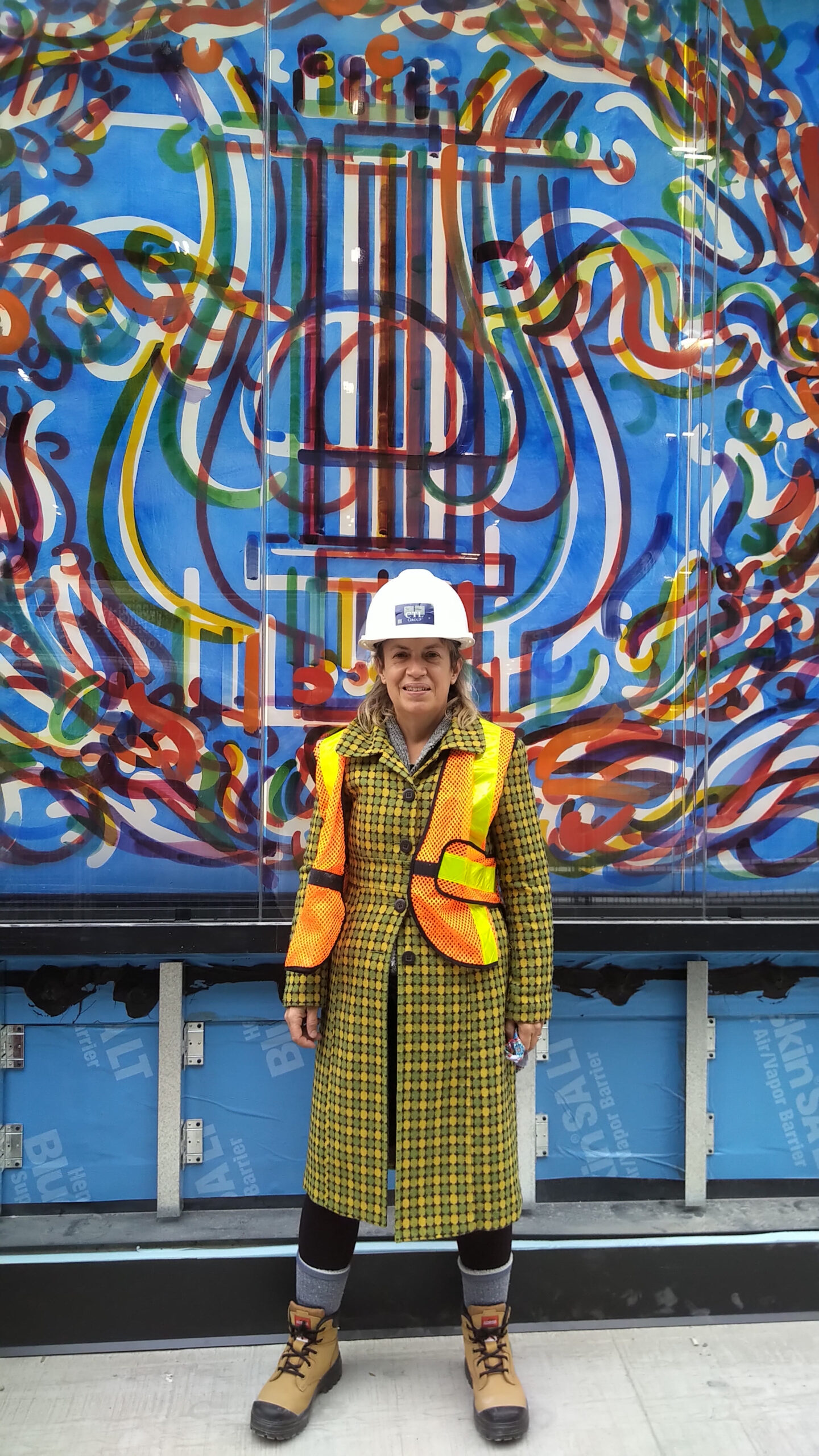 Katharine Harvey in Hard Hat outside of Toronto Public Art - Shea's Victoria
